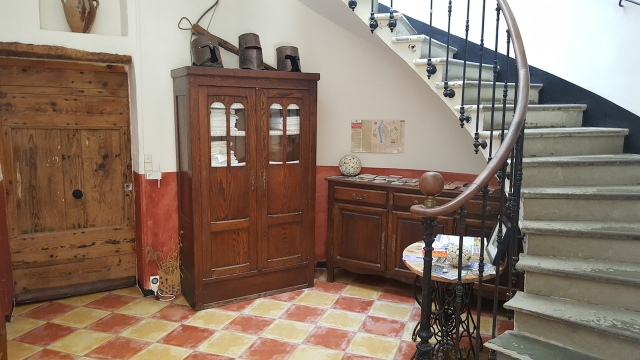The ground floor foyer inside our riverside medieval building. That's the door to our Balcony Gîte on the left.